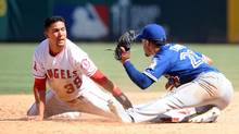 Los Angeles Angels left fielder Rafael Ortega steals second in the sixth inning against the tag of Toronto Blue Jays second baseman Devon Travis on Sept. 18, 2016. (Gary A. Vasquez/USA Today Sports)