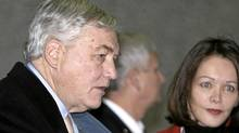 Conrad Black arrives with his wife Barbara Amiel at the Federal District Court in Chicago, Monday, Dec. 10, 2007, for sentencing in his racketeering and fraud trial. (M. Spencer Green/AP)