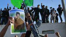 Supporters of Libyan leader Moammar Gadhafi demonstrate in Tripoli. (Jerome Delay/AP)