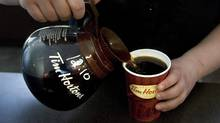 A cup of Tim Hortons coffee is poured as the company's financial year end results are announced at an AGM in Toronto on Friday May 14 2010. (CHRIS YOUNG/THE CANADIAN PRESS)