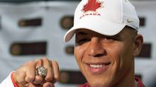Team Canada's Gold medal hockey team player Jarome Iginla shows off his Olympic ring as he talks to the media prior to the the Hockey Canada Foundation Celebrity Gala held at Commonwealth Stadium in Edmonton, Alberta on Monday, June 28, 2010. (John Ulan/THE CANADIAN PRESS)