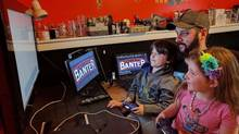 Kris Jardine plays video games as his seven-year-old daughter, Rowyn, and five-year-old son, Grayson, look on. (Kris Jardine/THE CANADIAN PRESS)