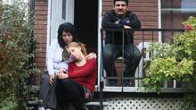 Trafficking victim Tibor Baranyai, right, with his wife, Ildiko Dellamario, and stepdaughter Ildiko Nagy in Lachine, Que., on Oct. 17, 2012. (Christinne Muschi/Christinne Muschi/The Globe and Mail)