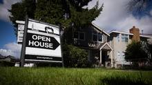 An open house sign is seen in front of a home listed for sale for $1.725-million in the neighbourhood of Arbutus, in Vancouver, B.C., on Saturday April 25, 2015. (DARRYL DYCK For The Globe and Mail)