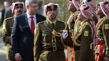 Prime Minister Stephen Harper inspects an honour guard as he meets with the Prime Minister of Jordan Abdullah Ensour in Amman, Jordan on Thursday, January 23, 2014. (Sean Kilpatrick/THE CANADIAN PRESS)