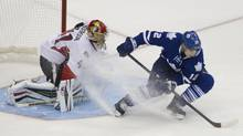 Mason Raymond stops, turns, and scores on the backhand against Craig Anderson during the shootout of the Leafs season opener against the Ottawa Senators at the ACC in Toronto on Oct. 5, 2013. (Peter Power/The Globe and Mail)