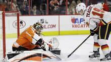 Philadelphia Flyers' Anthony Stolarz, left, cannot block a goal by Calgary Flames' Matthew Tkachuk during the third period of an NHL hockey game, Sunday, Nov. 27, 2016, in Philadelphia. (Matt Slocum/AP)