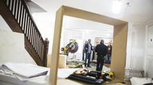 Chris Lawrence, co-owner of 3 Stones Custom Homes, left, talks with employees in a house his company is renovating in Toronto, on Friday, Nov. 14, 2014. (Matthew Sherwood For The Globe and Mail)