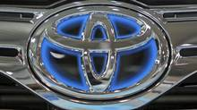The corporate logo of Toyota Motor Corp. shines on a vehicle on display at the company's showroom in Tokyo Thursday, Nov. 10, 2011. Toyota said Wednesday it is recalling about 550,000 vehicles worldwide, mostly in the United States for problems that could make it harder to steer. (Junji Kurokawa/Junji Kurokawa/AP)