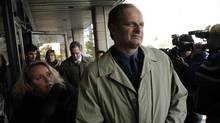 Staff Sgt. John Schertzer leaves provincial court in Scarborough in this Jan. 7, 2004, file photo. (J.P. MOCZULSKI/J.P. Moczulski/The Globe and Mail)