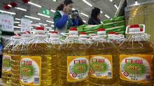 Bottles of cooking oil are for sale as people shop in a supermarket in Shenyang, in northeast China's Liaoning province. (AFP/AFP/Getty Images)