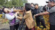 Participants fight during an opposition rally in the Kyrgyzstan capital of Bishkek on Wednesday. (VLADIMIR PIROGOV/REUTERS)