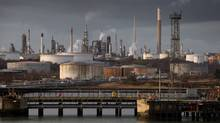 The Fawley oil refinery and Hamble oil terminal are seen on January 7, 2015 in Southampton, England. The International Monetary Fund has again cut its forecast for global economic growth, as the plunge in oil prices widens the rifts in the world economy. (Matt Cardy/Getty Images)