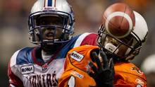 B.C. Lions' Arland Bruce III, right, just misses making the reception as Montreal Alouettes' De'Audra Dix looks on during the second half of a CFL football game in Vancouver, B.C., on Saturday November 5, 2011. THE CANADIAN PRESS/Darryl Dyck (Darryl Dyck/CP)