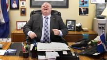 Toronto Mayor Rob Ford laughs during a year-end interview with The Globe and Mail in his office. (Peter Power/The Globe and Mail/Peter Power/The Globe and Mail)