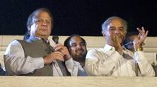 Pakistan Muslim League-N party Leader Nawaz Sharif, left, addresses supporters with his brother Shahbaz Sharif at the party's headquarters in Lahore, Pakistan, May 11, 2013. (Anjum Naveed/AP)