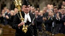 The Sergeant-at-Arms Kevin Vickers receives a standing ovation as he enters the House of Commons Thursday in Ottawa. (Adrian Wyld/The Canadian Press)