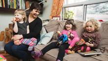 Jessica Lyons and her daughters, Ruby and Molly, and their friend Freda have a snack in their Toronto home on Wednesday. Ms. Lyons wants to make sure that hot-lunch programs in schools are inclusive to all children. (JENNIFER ROBERTS)