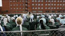 In this photo taken Aug. 22, 2012, inmates stand during a morning inspection at a women's prison in Sarapul, central Russia. Mark Feygin, a lawyer for the two jailed Pussy Riot band members said Monday, Oct. 22, 2012, that Maria Alekhina and Nadezhda Tolokonnikova were transferred during the weekend from Moscow prison, where they were kept since March. (Yuri Tutov/AP)