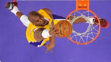 Los Angeles Lakers guard Kobe Bryant goes up for a dunk during the second half of their NBA basketball game against the Los Angeles Clippers, Thursday, Feb. 14, 2013, in Los Angeles. (Mark J. Terrill/AP)