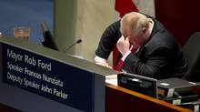 Mayor Rob Ford puts his head in his hand shaking it, in chambers at City Hall in Toronto on November 18, 2013 during a special council meeting to limit more of his powers. (Deborah Baic/The Globe and Mail)