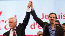 Liberal interim Leader Bob Rae holds up the hand of newly-elected Liberal party president Mike Crawley as they celebrate his victory at the Liberal Biennal Convention in Ottawa. (Sean Kilpatrick/The Canadian Press/Sean Kilpatrick/The Canadian Press)