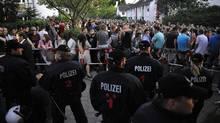Police officers control partygoers in Hamburg, Germany, on June 3. (Stefan Simonsen/AP)