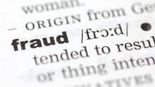 A close up of the word fraud from a dictionary.