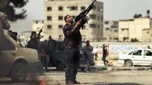 A Palestinian fires a weapon into the air during the funeral of Islamic Jihad militant Mohammed Daher in Gaza City on March 13, 2012. (Suhaib Salem/Reuters/Suhaib Salem/Reuters)