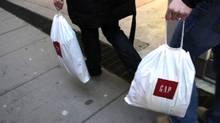 Plastic bags from Gap store are carried by people shopping on Bloor St., Toronto, in 2008. (Fernando Morales/The Globe and Mail)