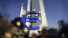 The euro sculpture is pictured in front of the headquarters of the European Central Bank in Frankfurt. (KAI PFAFFENBACH/REUTERS)