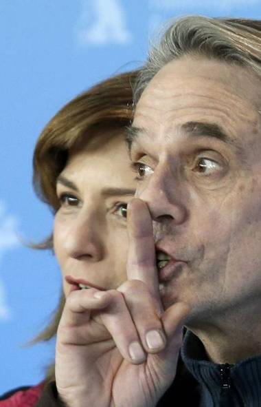 Why is Jeremy Irons, seen here with German actress Martina Gedeck, asking everyone to keep quiet at the Berlinale International Film Festival in Berlin last week? (Tobias Schwarz/Reuters)