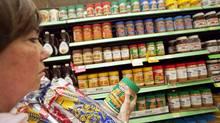 Debbie Taylor shops for peanut butter at the Heartland Walmart in Mississaga. (JENNIFER ROBERTS/JENNIFER ROBERTS For The Globe and Mail)