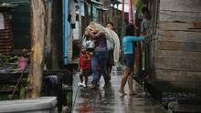 People carrying belongings before Hurricane Otto hits Bluefields, Nicaragua, on Nov. 24, 2016. (INTI OCON/AFP/Getty Images)