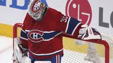 Montreal Canadiens' goalie Peter Budaj pauses after conceding a goal to the Ottawa Senators during the third period in Game 5 of their NHL Eastern Conference quarterfinal playoff series in Montreal, May 9, 2013. (CHRISTINNE MUSCHI/REUTERS)