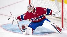 Montreal Canadiens goalie Carey Price deflects a shot as they face the Toronto Maple Leafs during first period of NHL pre-season hockey action Thursday, October 6, 2016 in Montreal. (Paul Chiasson/THE CANADIAN PRESS)