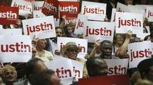 Supporters hold up banners prior to Liberal MP Justin Trudeau announcing his run for the leadership of the Liberal party in Montreal on Oct. 2, 2012. (CHRISTINNE MUSCHI/REUTERS)