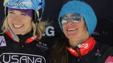 (L-R) Dominique Maltas and Maelle Ricker of Canada take the podium in second place in the ladies' team snowboardcross at the LG Snowboard FIS World Cup on December 17, 2011 in Telluride, Colorado. (Photo by Doug Pensinger/Getty Images) (Doug Pensinger/Getty Images)