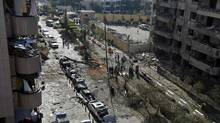 The site of explosions near the Iranian embassy in Beirut, is seen in this general view November 19, 2013. Two explosions, at least one caused by a suicide bomber, rocked Iran's embassy in Lebanon on Tuesday, killing at least 23 people, including an Iranian cultural attache, and hurling bodies, cars and debris across the street. (MOHAMED AZAKIR/REUTERS)