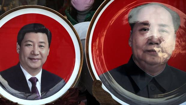 Past and present: Souvenir plates for sale new Tiananmen Square in Beijing honour Chairman Mao and President Xi, left, who has assembled more personal leverage over state power than was allowed in Mao's consensus-rule system.