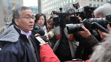 """Weizhen Tang talks to reporters while on a lunch break during a sentencing hearing in Toronto on Jan. 9, 2013. The Ontario Securities Commission has filed new allegations against Mr. Tang, who called himself a """"Chinese Warren Buffett"""" while raising $50-million from investors. (J.P. Moczulski for The Globe and Mail)"""