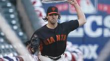 San Francisco Giants starting pitcher Barry Zito warms-up his arm with a towel during practice for the World Series in San Francisco Oct. 23, 2012. (LUCY NICHOLSON/REUTERS)