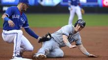 The Blue Jays' Josh Donaldson tags out Corey Dickerson of the Tampa Bay Rays as he attempts to steal third base on Tuesday. (Tom Szczerbowski/Getty Images)