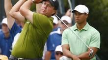 Phil Mickelson (L) hits from the 10th tee as Tiger Woods watches during the second round of the 108th U.S. Open golf championship at Torrey Pines in San Diego June 13, 2008. (MIKE BLAKE/REUTERS)