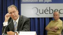 Former Quebec Minister of Justice Marc Bellemare adjusts his glasses while he testifies during the Inquiry Commission into the appointment process for judges in Quebec City, August 24, 2010. (POOL/REUTERS)