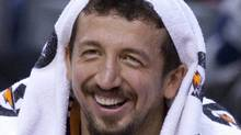 Phoenix Suns forward Hedo Turkoglu smiles on the bench during first half NBA action against the Toronto Raptors in Toronto on Sunday October 17, 2010. THE CANADIAN PRESS/Frank Gunn (FRANK GUNN)