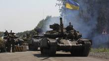 Ukrainian government forces recaptured an important railway hub from pro-Russian rebels in the east of the country, with five soldiers killed and 15 others wounded over the last 24 hours. (VALENTYN OGIRENKO/REUTERS)