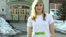 Grade 10 St. Patrick High School student Alexandria Szeglet stands in front of the school she was sent home from Thursday after wearing a pro-choice message on her uniform. (Jodi Lundmark, tbnewswatch.com)