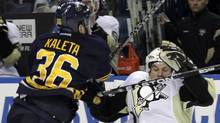 Buffalo Sabres' Patrick Kaleta (36) checks Pittsburgh Penguins' Sidney Crosby (87) during the second period of an NHL hockey game in Buffalo, N.Y., Friday, March 30, 2012 (AP)