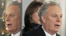 Quebec Premier Jean Charest is reflected on a television screen as he responds to questions at the news conference marking the end of the fall session Friday, December 10, 2010, at the legislature in Quebec City. (Jacques Boissinot/The Canadian Press/Jacques Boissinot/The Canadian Press)